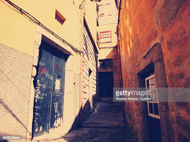 alley amidst buildings on sunny day - moura stock photos and pictures
