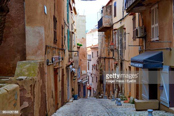 alley amidst buildings - corsica stock-fotos und bilder