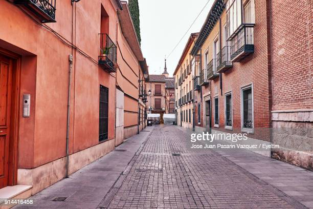 alley amidst houses against sky - alcala de henares stock pictures, royalty-free photos & images
