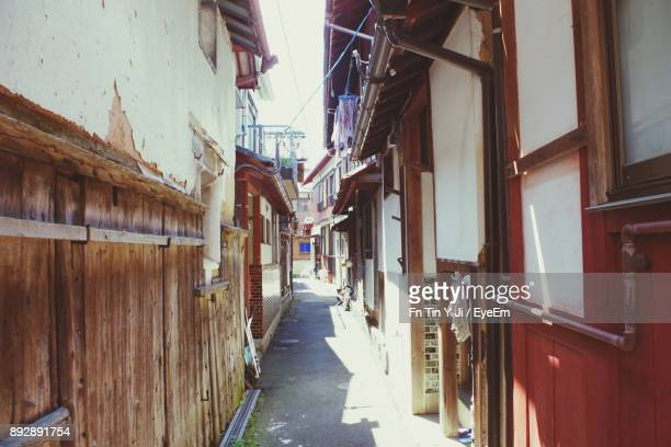 alley amidst houses in city - 福井県 ストックフォトと画像