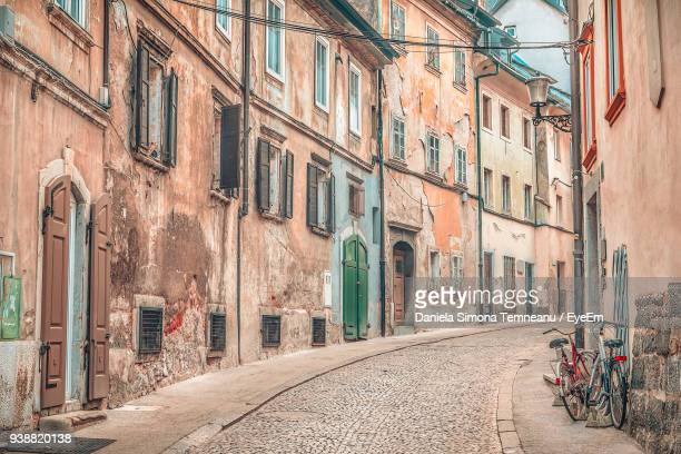 alley amidst residential buildings - ljubljana stock pictures, royalty-free photos & images