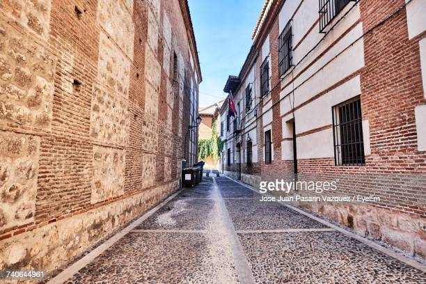 alley amidst street in city against sky - alcala de henares stock pictures, royalty-free photos & images