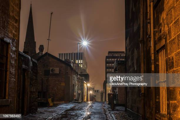alley and spire - old glasgow stock pictures, royalty-free photos & images
