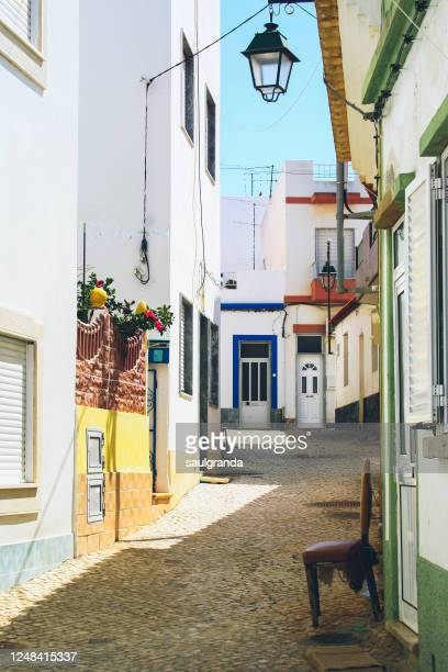 alley in a small village of the algarve - faro district portugal stock pictures, royalty-free photos & images