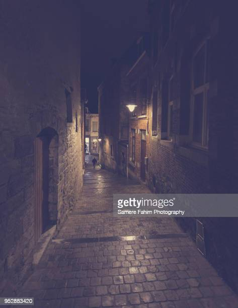 alley in mons by night - samere fahim stock photos and pictures