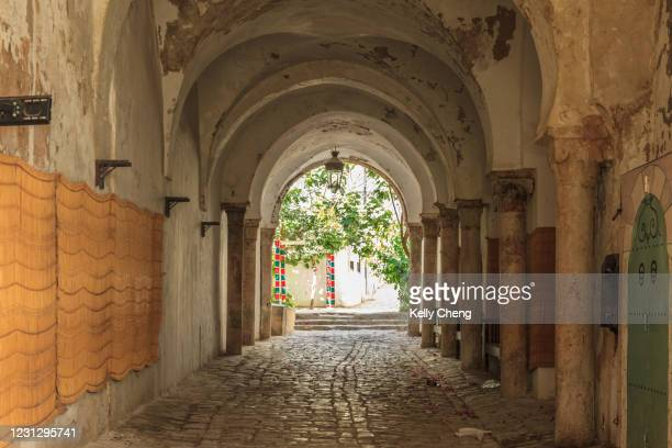 alley in the medina of tunis - unesco world heritage site stock pictures, royalty-free photos & images