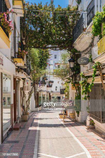 alley in the old own of marbella, spain - südeuropa stock-fotos und bilder