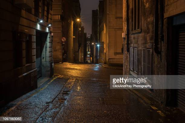 alley in the rain - old glasgow stock pictures, royalty-free photos & images