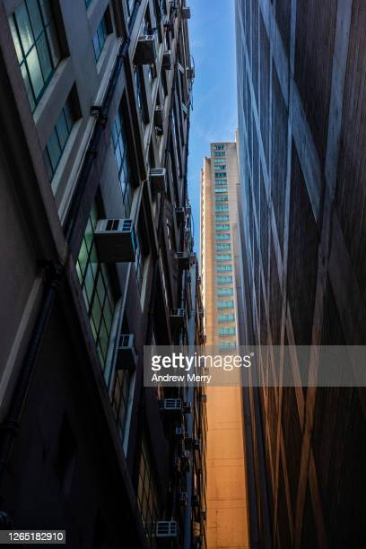 alley, narrow lane between high rise buildings, skyscrapers, city skyline - high contrast stock pictures, royalty-free photos & images