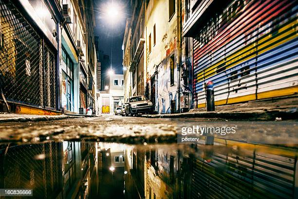 alley reflections. - ghetto trash stock pictures, royalty-free photos & images