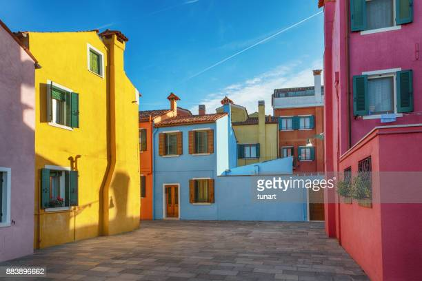 alleys of colorful buildings of burano, venice, italy - multi colored stock pictures, royalty-free photos & images
