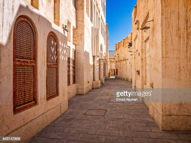 alleyway in souq waqif, doha, qatar - doha stock pictures, royalty-free photos & images