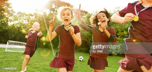 all-girls soccer team celebrating the victory - sports league stock pictures, royalty-free photos & images