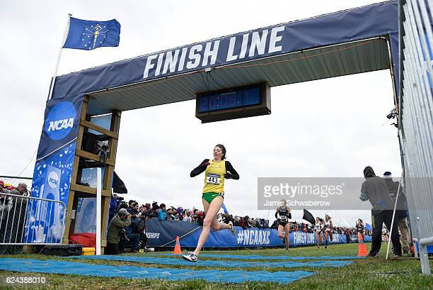 Alli Cash of the University of Oregon crosses the finish line during the Division I Men's and Women's Cross Country Championship held at the Wabash...