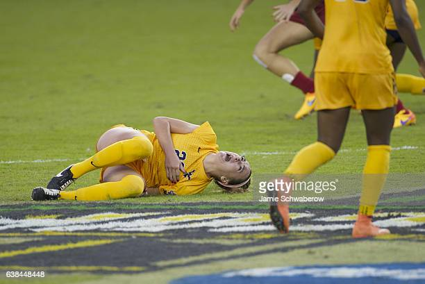 Alli Magaletta of West Virginia University is injured against the University of Southern California during the Division I Women's Soccer Championship...