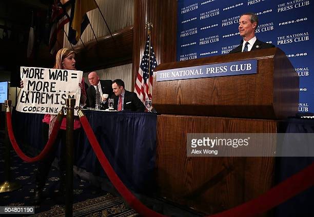 Alli McCracken of CODEPINK stages a protest as Chairman of the House Armed Services Committee Rep. Mac Thornberry speaks during a National Press Club...