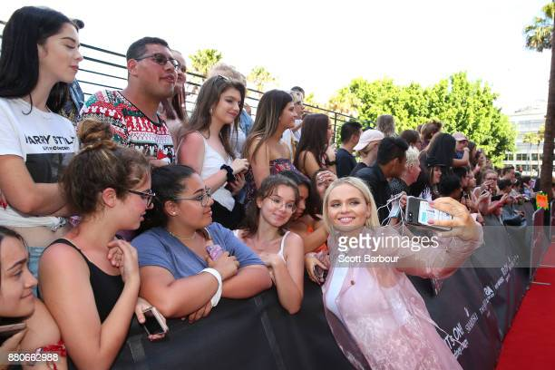 Alli Simpson poses with fans on the red carpet ahead of the 31st Annual ARIA Awards 2017 at The Star on November 28 2017 in Sydney Australia