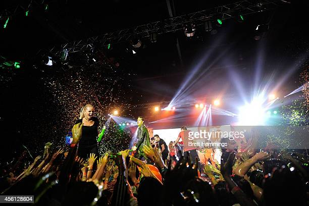 Alli Simpson slimes the audience during the Nickelodeon Slimefest 2014 evening show at Sydney Olympic Park Sports Centre on September 26 2014 in...