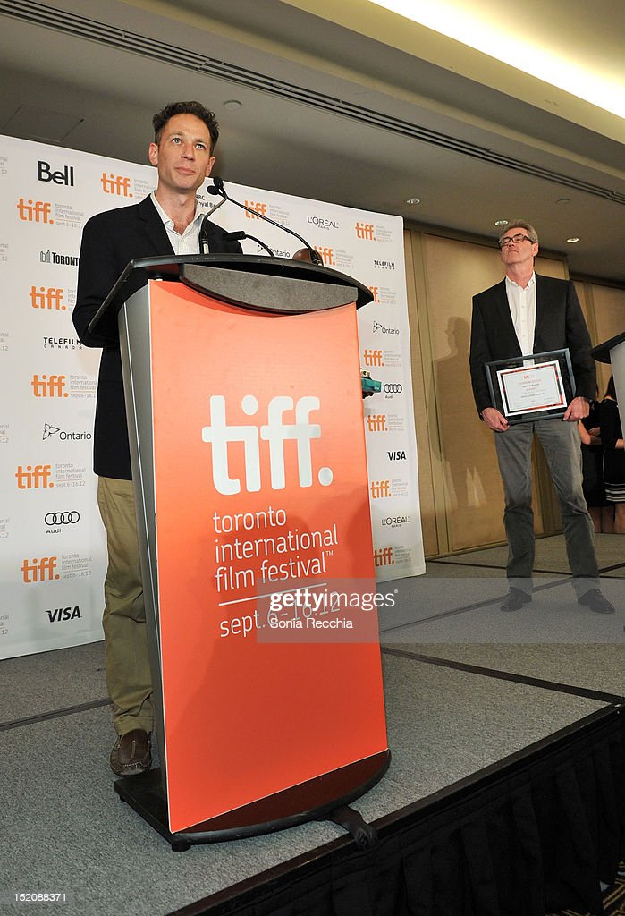 Alliance Films' Mark Slone (L) accepts the Blackberry People's Choice Award for 'Silver Linings Playbook' on behalf of filmmaker David O. Russell as TIFF Director and CEO Piers Handling looks on at the 37th Toronto International Film Festival Award Winner Ceremony held at the InterContinental Toronto Center Hotel on September 16, 2012 in Toronto, Canada.