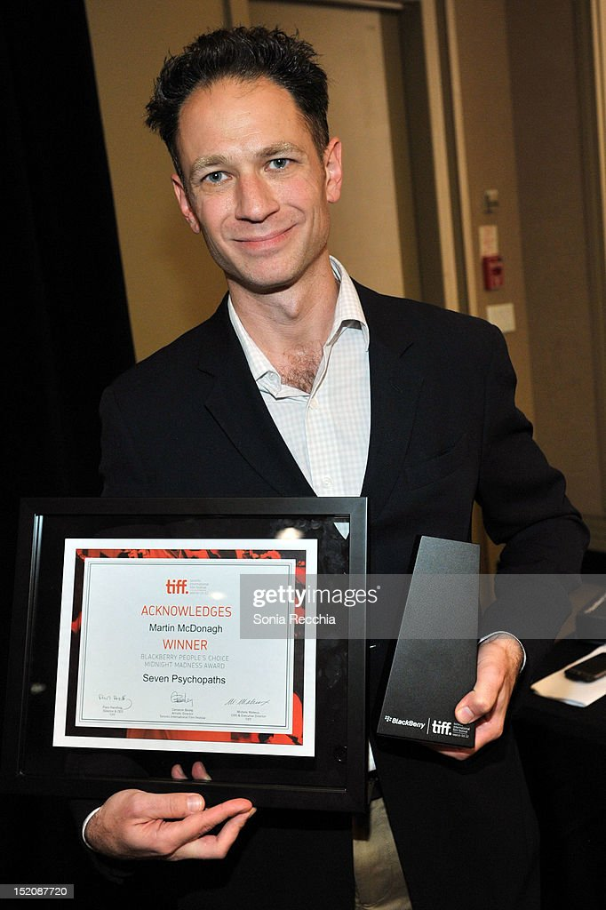 Alliance Films' Mark Slone accepts the Blackberry People's Choice Midnight Madness Award for 'Seven Psychopaths' on behalf of filmmaker Martin McDonagh at the 37th Toronto International Film Festival Award Winner Ceremony held at the InterContinental Toronto Center Hotel on September 16, 2012 in Toronto, Canada.
