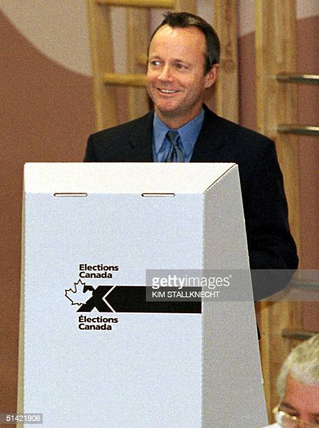 Alliance Party leader Stockwell Day casts his vote at the polling booth early 27 November 2000 at Trout Lake Elementary School in Summerland British...
