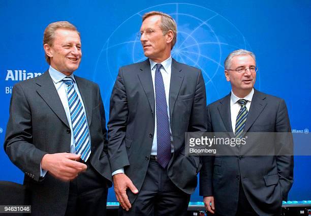 Allianz Chief Executive Michael Diekmann center Allianz Management Board Member Helmut Perlet left and Allianz Chief Financial Officer Paul...