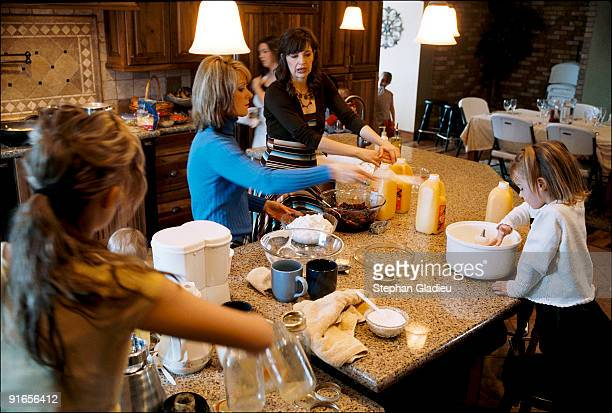 Allie and Valerie , two wives in a polygamist family consisting of one man, three women and 21 children, make breakfast for their entire family with...