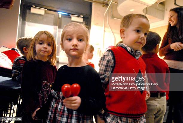 Allie Darter left Rachel Hirschman and Chris Davis the 4 year olds wait back stage before singing Feliz Navidad with their class at the City of...
