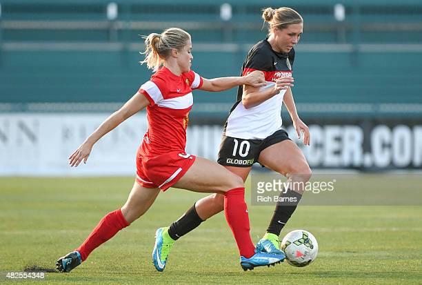 Allie Long of Portland Thorns FC controls the ball against the defense of Abigail Dahlkemper of the Western New York Flash during the first half at...
