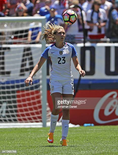 Allie Long of the United States heads the ball against South Africa during a friendly match at Soldier Field on July 9 2016 in Chicago Illinois