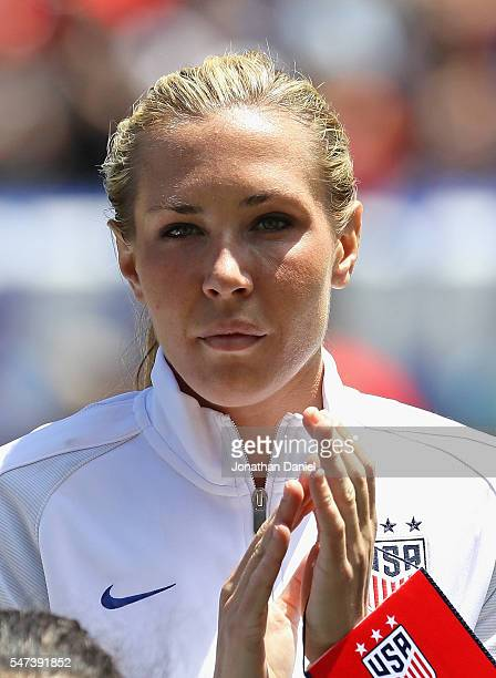 Allie Long of the United States stands during team introductions before a friendly match against South Africa at Soldier Field on July 9 2016 in...
