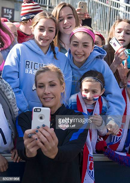 Allie Long of the United States takes a selfie with fans after the match against Colombia at Talen Energy Stadium on April 10 2016 in Chester...