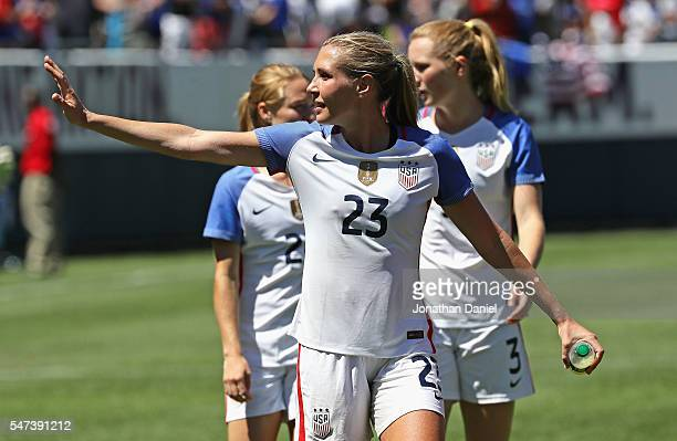 Allie Long of the United States waves to fans after a win over South Africa during a friendly match at Soldier Field on July 9 2016 in Chicago...