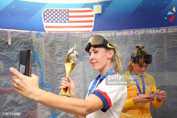 Allie Long of the USA poses for a selfie with the Champions trophy after the 2019 FIFA Women's World Cup France Final match between The United State...