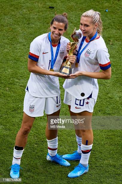 Allie Long of the USA poses with the FIFA World Cup trophy next to her teammate Tobin Heath of the USA during the 2019 FIFA Women's World Cup France...