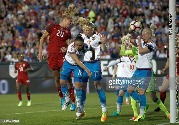 Allie Long of the USA scores on a header as she is defended by Elvira Ziiastinova of Russia during the first half of the International Friendly...