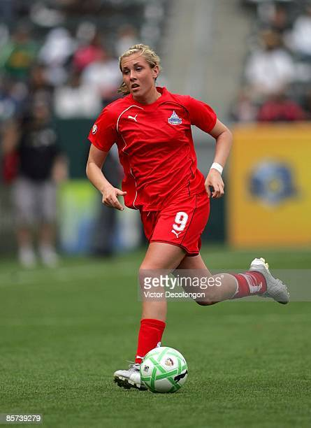 Allie Long of the Washington Freedom paces the ball on the right wing during their inaugural WPS match against the Los Angeles Sol at The Home Depot...