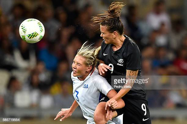 Allie Long of United States and Amber Hearn of New Zealand battle for the ball during the Women's Group G first round match between the United States...