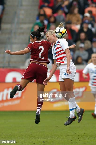 Allie Long of United States heads the ball away from Kenti Robles of Mexico in the second half at BBVA Compass Stadium on April 8 2018 in Houston...