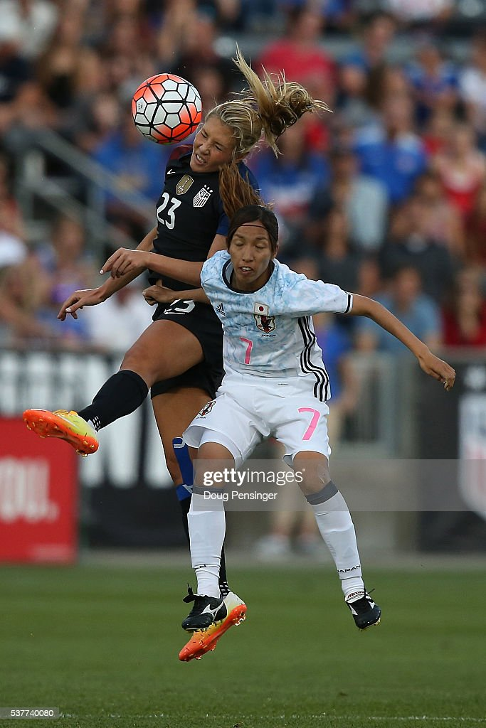 Allie Long #23 of United States of America and Emi Nakajima #7 of Japan battle for a head ball during an international friendly match at Dick's Sporting Goods Park on June 2, 2016 in Commerce City, Colorado.
