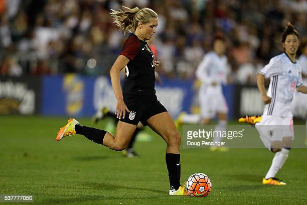 Allie Long of United States of America passes the ball against the Japan during an international friendly match at Dick's Sporting Goods Park on June...