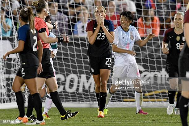 Allie Long of US Women's National Team reacts to narrowly missing a goal against Japan during the second half of their 33 tie The US Women's National...
