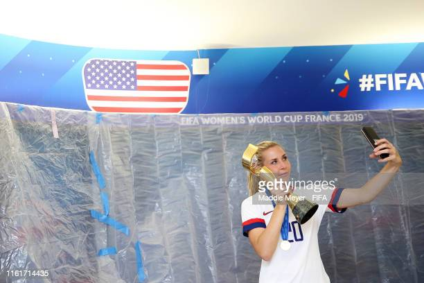 Allie Long poses for a selfie with the Championship trophy in the locker room after the 2019 FIFA Women's World Cup France Final match between The...