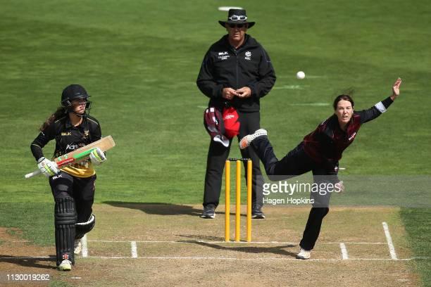Allie MaceCochrane of Canterbury bowls while Amelia Kerr of Wellington looks on during the Hallyburton Johnstone Shield match between the Wellington...