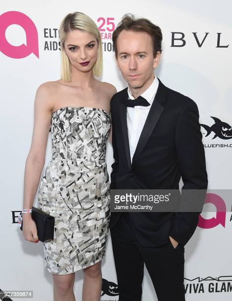 Allie Marie Evans and Tyler Shields attend the 26th annual Elton John AIDS Foundation Academy Awards Viewing Party sponsored by Bulgari celebrating...