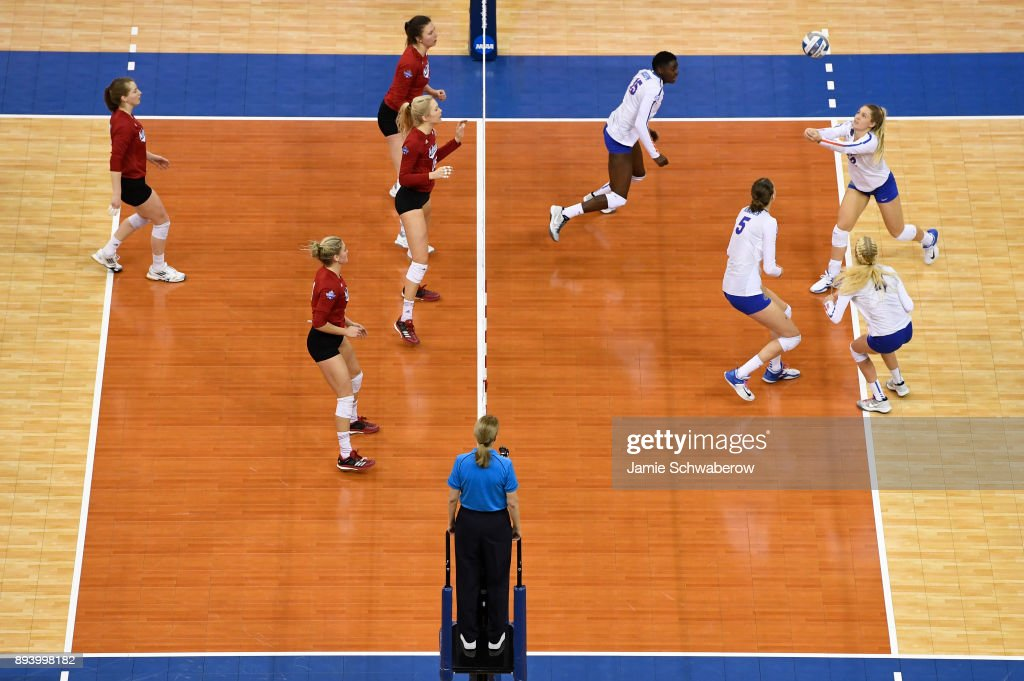 Allie Monserez (22) of the University of Florida bumps the ball during the Division I Women's Volleyball Championship held at Sprint Center on December 16, 2017 in Kansas City, Missouri.