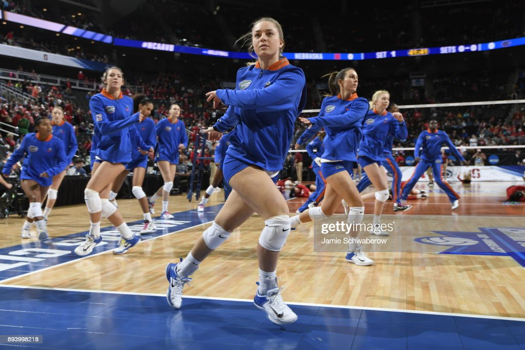 Allie Monserez (22) of the University of Florida warms up with teammates during the Division I Women's Volleyball Championship held at Sprint Center on December 16, 2017 in Kansas City, Missouri.