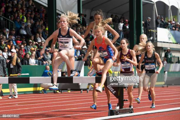 Allie Ostrander of Boise State University and Tori Gerlach of Penn State University lead the pack in the 3000 meter steeplechase during the Division...