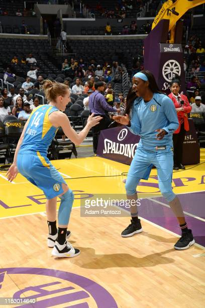Allie Quigley highfives Chloe Jackson of the Chicago Sky before the game against the Los Angeles Sparks on June 30 2019 at the Staples Center in Los...