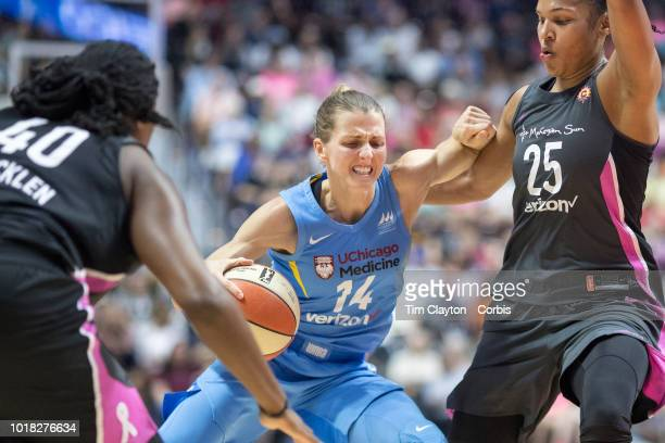 Allie Quigley of the Chicago Sky defended by Alyssa Thomas of the Connecticut Sun and Shekinna Stricklen of the Connecticut Sun during the...